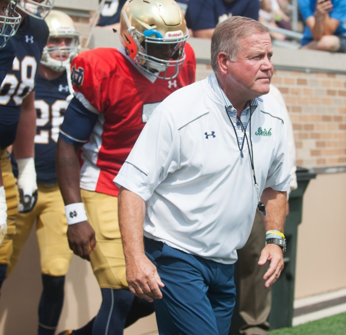 Irish head coach Brian Kelly takes the field during the New and Gold scrimmage Sunday at the newly-renovated Notre Dame Stadium.