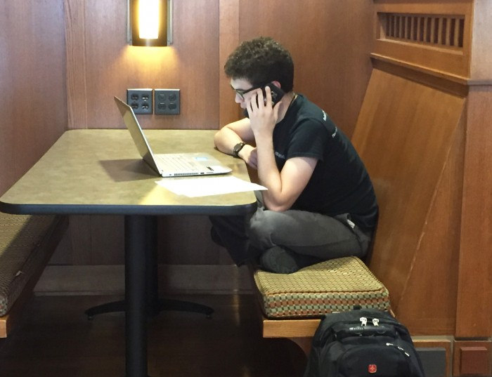 A student calls his representatives Wednesday to advocate for immigration awareness in response to President Donald Trump's decision Tuesday to rescind the DACA program, effective in six months.