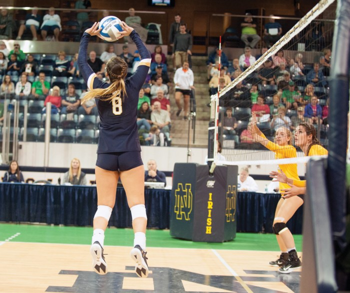 Irish senior setter Caroline Holt sets the ball during Notre Dame's 3-1 win over Valparaiso on Aug. 25 at Compton Family Ice Arena. Holt tallied 49 assists during the match.