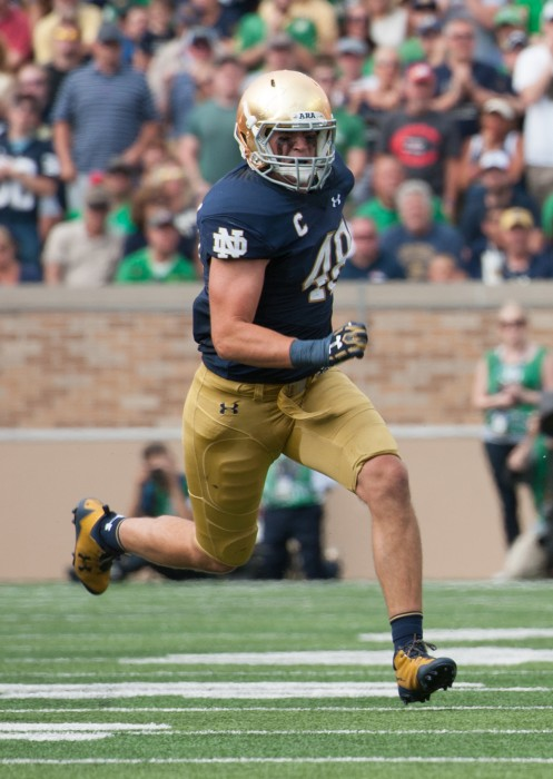 Irish senior linebacker Greer Martini runs towards the play during Notre Dame's 49-16 victory over Temple on Sept. 2 at Notre Dame Stadium. Martini recorded six tackles and a forced fumble in the contest.