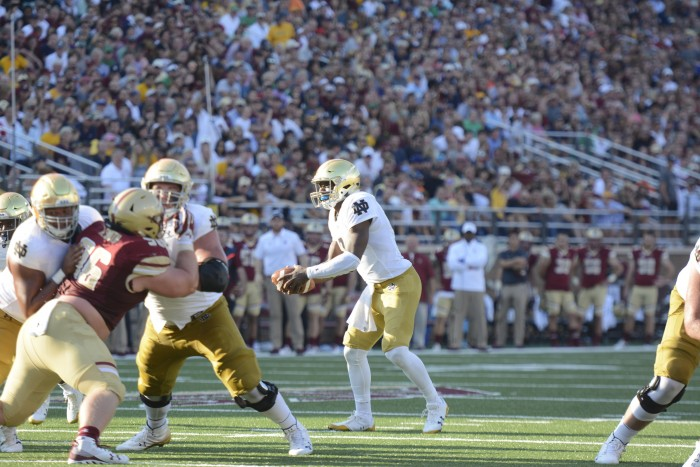 Irish junior quarterback Brandon Wimbush reads the defense during Notre Dame's 49-20 victory over Boston College on Saturday. Wimbush had 207 rushing yards with four touchdowns and 96 passing yards.