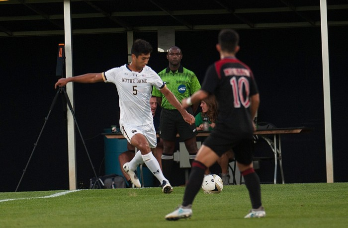 Irish junior defender Felicien Dumas whips in a cross during Notre Dame's 3-0 victory over North Carolina State on Friday.