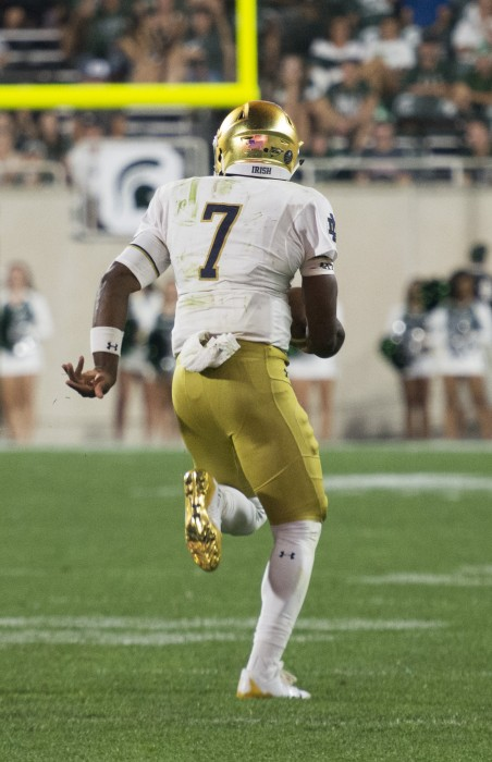 Irish junior quarterback Brandon Wimbush carries the ball upfield during Notre Dame's 38-18 win over Michigan State on Saturday at Spartan Stadium.