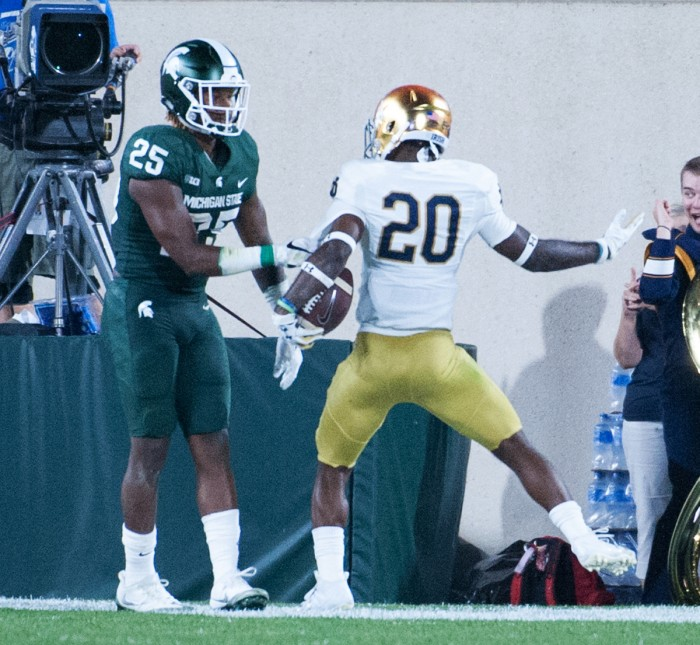 Irish junior cornerback Shaun Crawford celebrates after stripping the ball on the goal line and recovering the fumble in the endzone during Notre Dame's 38-18 win over Michigan State on Saturday.