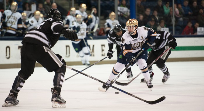 Irish senior forward Jake Evans faces a defender during Notre Dame's 5-2 victory over Providence at Compton Family Ice Arena on Mar. 11. Evans finished last season with 13 goals and 29 assists for a total of 42 points in 40 games. Evans earned the second most points on the team, behind Anders Bjork, who graduated and now plays for the Boston Bruins.