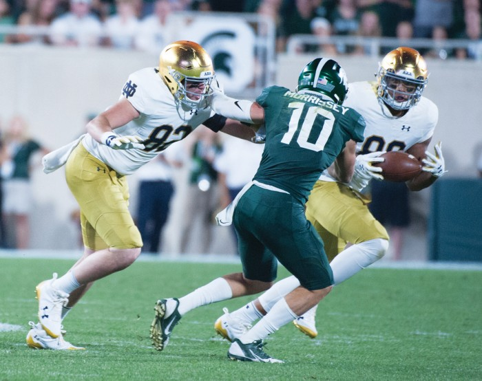 Irish junior tight end Alize Mack dodges a defender during Notre Dame's 38-18 win over Michigan State on Saturday in East Lansing, Michigan.