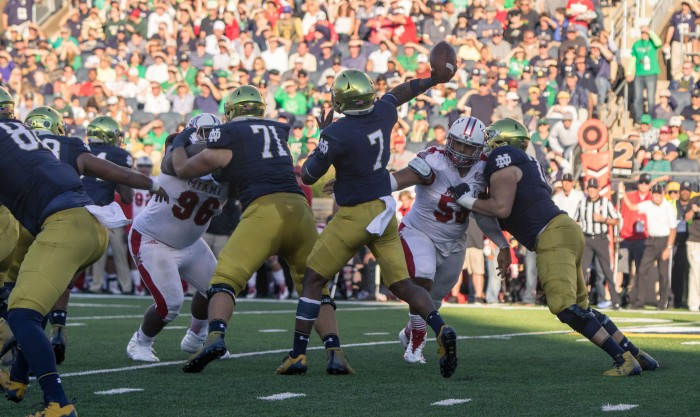 Irish junior quarterback Brandon Wimbush fires a pass during Notre Dame's 52-17 win over Miami (OH) on Saturday at Notre Dame Stadium.