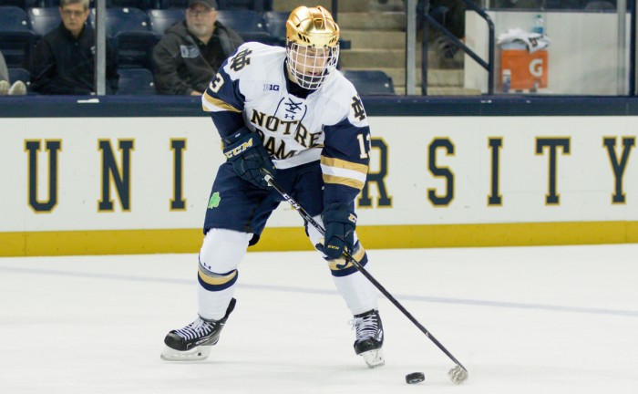 Irish freshman forward Colin Theisen skates with the puck during Notre Dame's 4-3 win over USNTDP on Sunday at Compton Family Ice Arena.