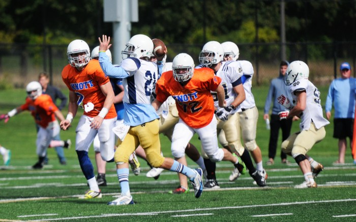 Otters sophomore quarterback Xavier Lezynski throws a pass while rolling out during Sorin's 8-0 loss to Knott on Sunday.
