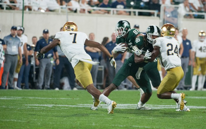 Irish senior cornerback Nick Watkins looks to cut off Spartans junior tight end Matt Sokol during Notre Dame's 38-18 win over Michigan State on Sept. 23 at Spartan Stadium in East Lansing, Michigan.