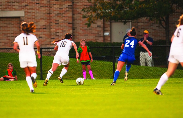 Irish graduate student midfielder Sandra Yu, middle, dribbles across the pitch during Notre Dame's 3-0 loss to Duke on Sept. 21.
