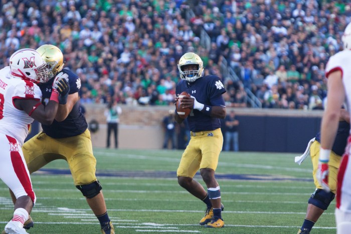 Irish junior quarterback Brandon Wimbush drops back to pass and surveys the field during Notre Dame's 52-17 win over Miami (OH) on Saturday at Notre Dame Stadium. Wimbush passed for 119 yards.