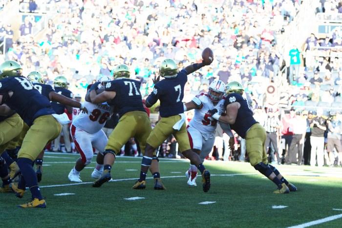Irish junior quarterback Brandon Wimbush fires a pass under pressure during Notre Dame's 52-17 win over Miami (OH) on Saturday at Notre Dame Stadium.