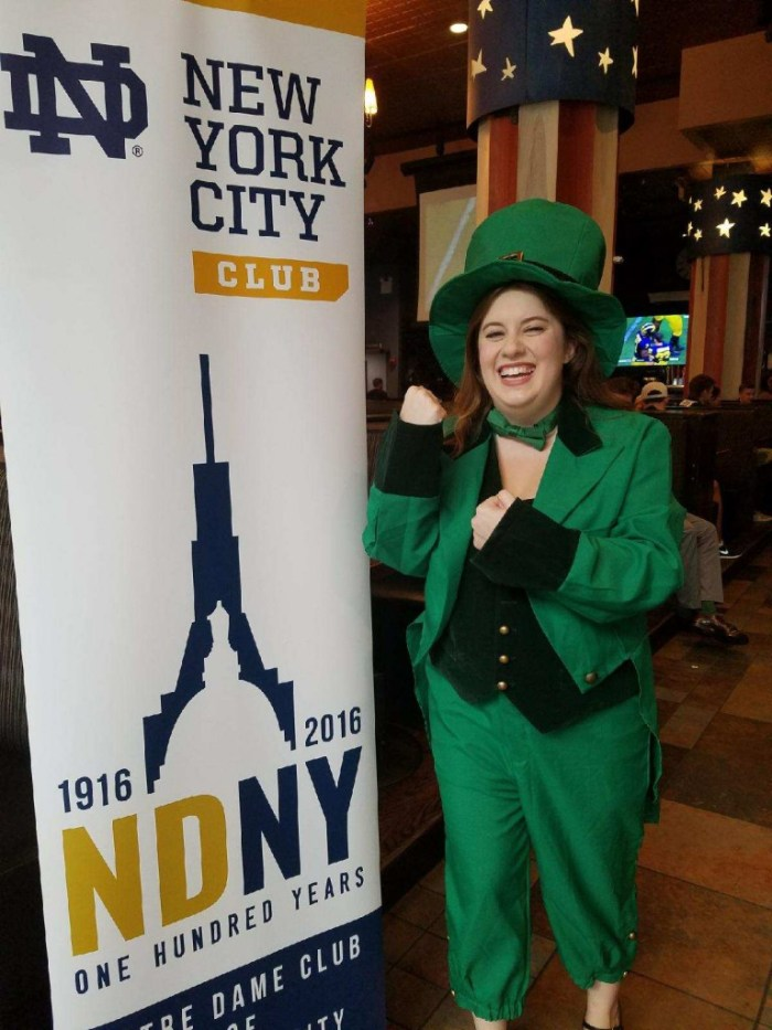 A Notre Dame alumna and member of the Notre Dame Club of New York poses in a leprechaun costume at one an NDNY game watch at the Public House.