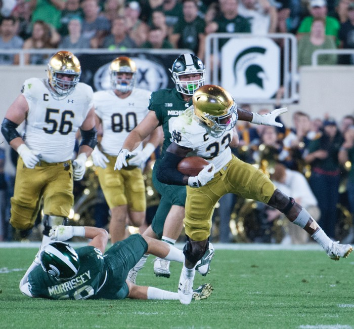 Junior Irish running back Josh Adams tries to keep his balance after breaking a tackle during Notre Dame's 38-18 win over Michigan State on Sept. 23.