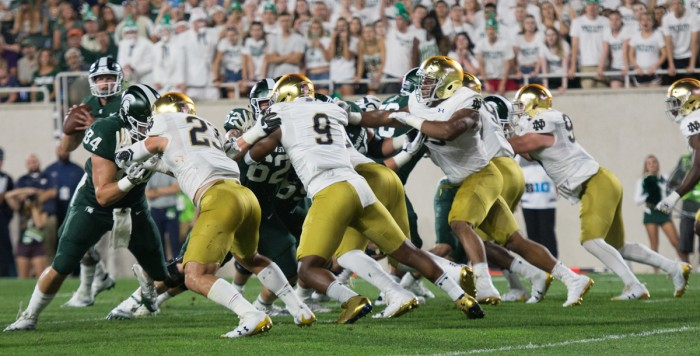 Irish sophomore defensive lineman Daelin Hayes, second from the left, fights against a block during Notre Dame's 38-18 victory over Michigan State on Sept. 23 at Spartan Stadium in East Lansing, Michigan. Hayes has recorded 14 tackles and two sacks this season. Hayes played in all 12 games last season after suffering multiple injuries in high school.
