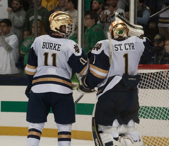 Irish sophomore forward Cal Burke and freshman goaltender Dylan St. Cyr talk during a break in the action during Notre Dame's 2-2 tie against Denver on Oct. 13 at Compton Family Ice Arena. St. Cyr finished with 46 saves on the night.