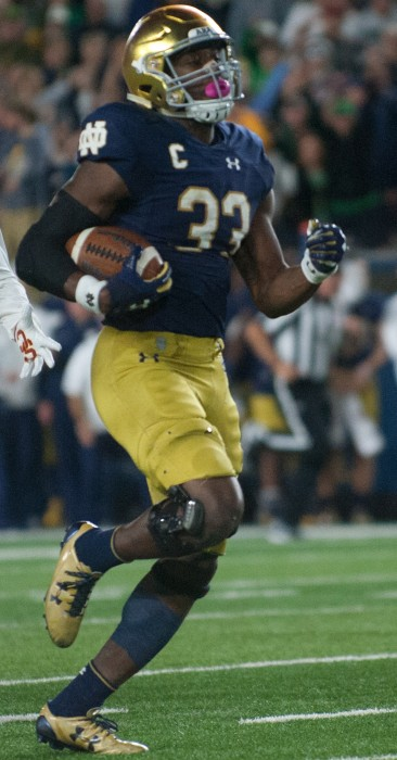 Irish junior running back Josh Adams sprints down the field during Notre Dame's 49-14 victory over USC on Saturday at Notre Dame Stadium.