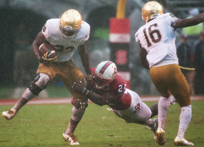 Irish junior tailback attempts to evade a diving Wolfpack defender during Notre Dame's 10-3 loss to North Carolina State on Oct. 8, 2016.