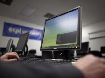 man_working_on_dell_pc_reuters.jpg