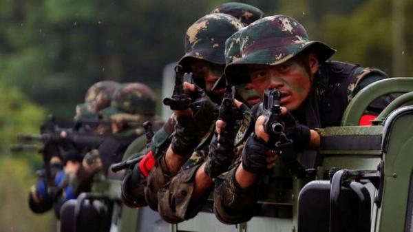 China flexes military muscle in a show of force to the West
