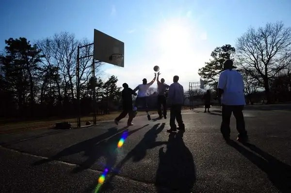 A file photo of kids playing basketball at