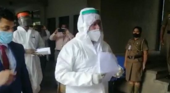 (VIDEO) Rishad Bathiudeen comes to Parliament in PPE