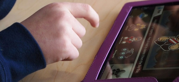 An elementary student used an iPad in a school.