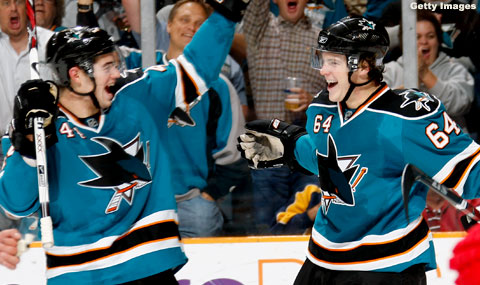 Marc-Edouard Vlasic celebrates with Jamie McGinn after McGinn notched his first career goal