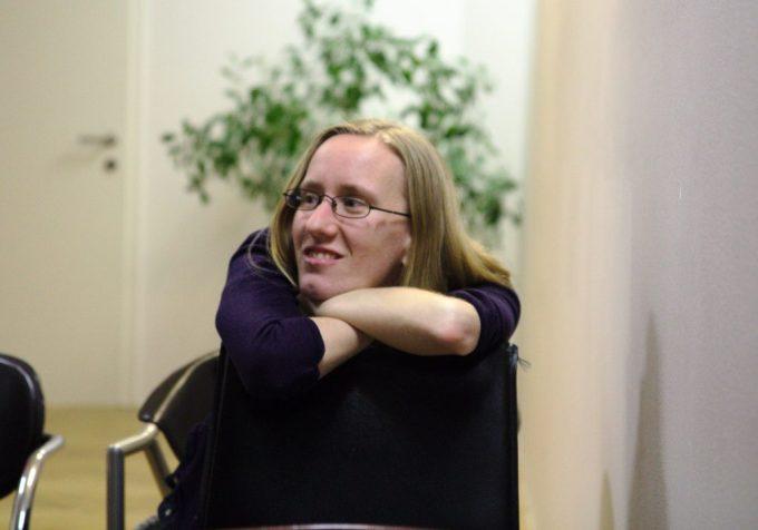 Lujza Kotryová smiling in a chair