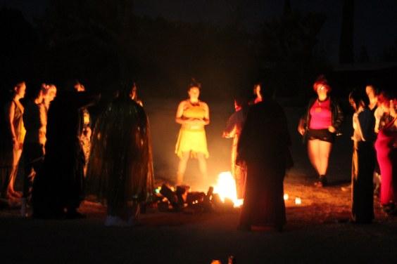 Women gathered around a bonfire