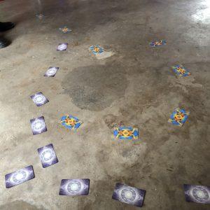 tarot cards face down on a concrete floor