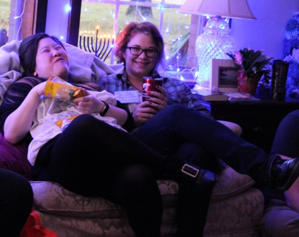 two people on a couch smiling
