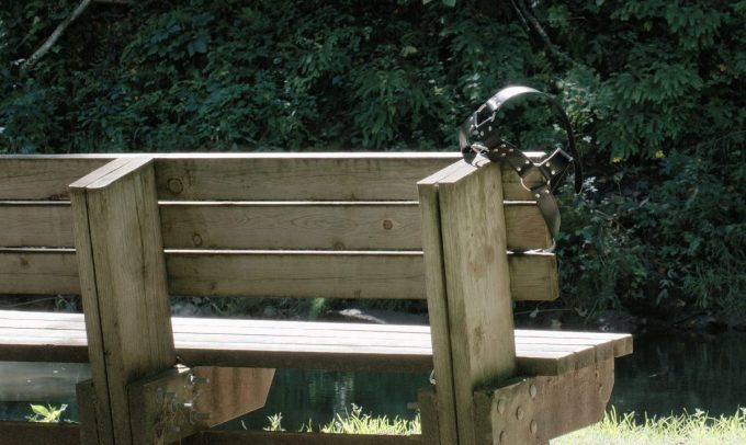 A leather harness hanging on a bench in Whitewater State Park. Photo by l.p. lade.