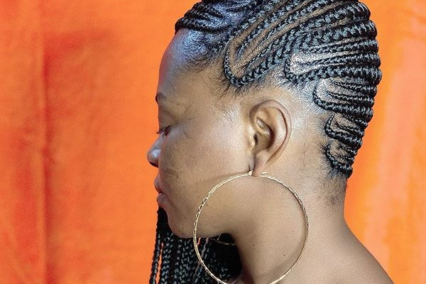 The side Cornrow braids are cool.