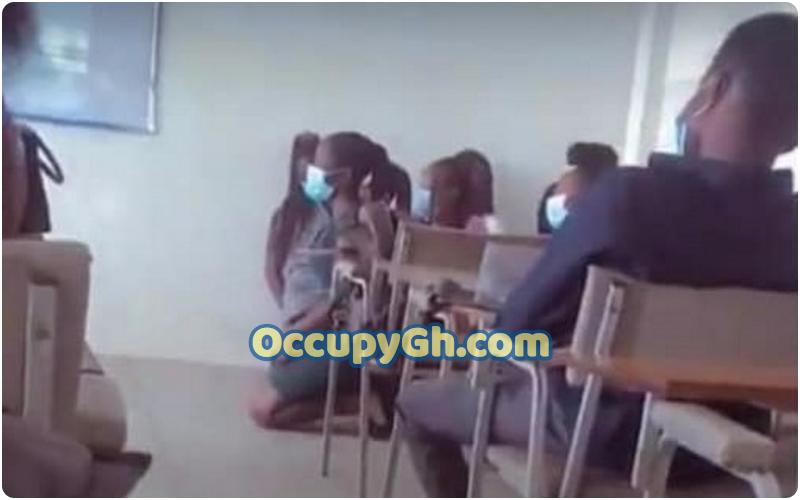 upsa students kneeling lecture hall