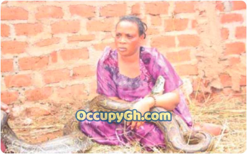 woman caught breastfeeding snake
