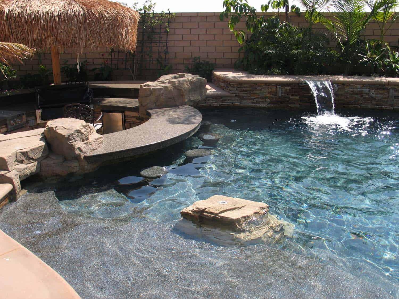 33 Mega-Impressive swim-up pool bars built for entertaining on Backyard Pool Bar Designs  id=82815