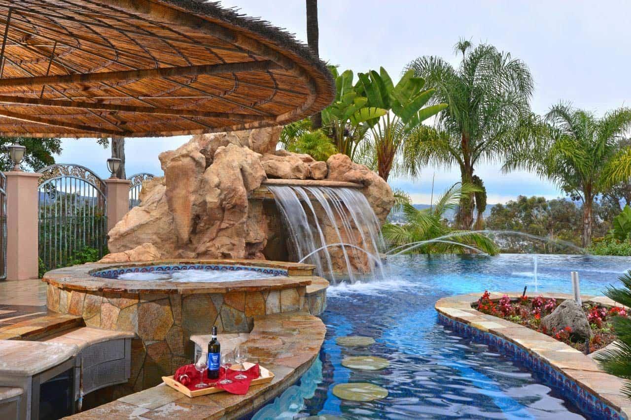 33 Mega-Impressive swim-up pool bars built for entertaining on Backyard Pool Bar Designs  id=29964