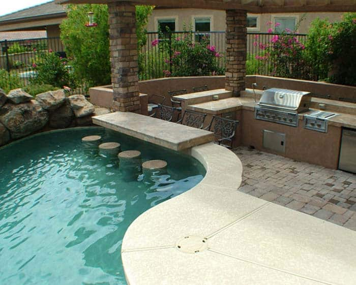 33 Mega-Impressive swim-up pool bars built for entertaining on Backyard Pool Bar Designs  id=14848