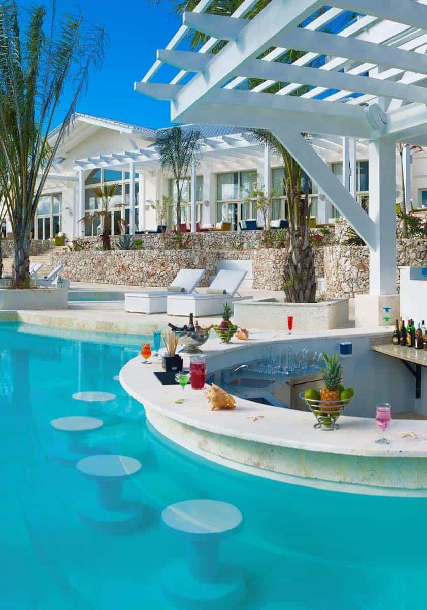 33 Mega-Impressive swim-up pool bars built for entertaining on Backyard Pool Bar Designs  id=73921