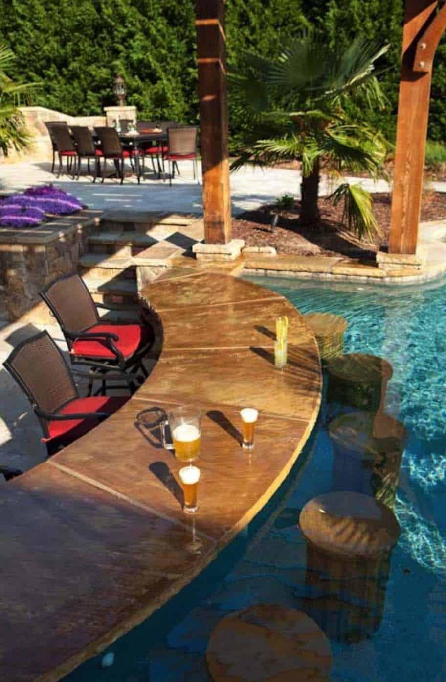 33 Mega-Impressive swim-up pool bars built for entertaining on Backyard Pool Bar Designs  id=16501