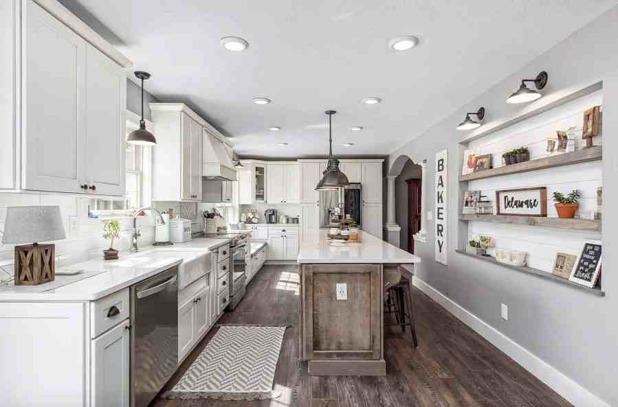 35  Amazingly creative and stylish farmhouse kitchen ideas This striking kitchen features Caesarstone countertops  The white of the  countertops contrasts beautifully with the black stained cabinets