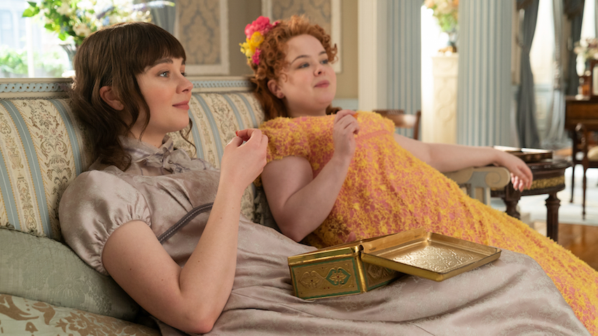Bridgerton - Claudia Jessie as Eloise Bridgerton (left) and Nicola Coughlan as Penelope Featherington (right)
