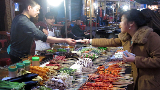 Buying BBQ street food at a night market in Sichuan Province, China. ©KettiWilhelm2015