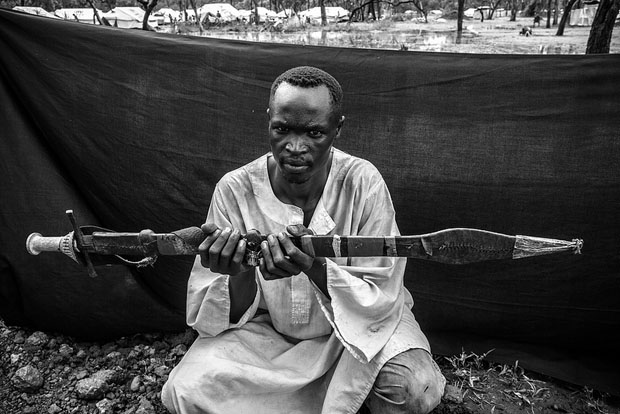 The most important object Howard was able to bring with him is the long knife he holds, called a shefe, which he used to defend his family and his herd of 20 cattle during their 20-day journey from Bau County to the South Sudanese border.