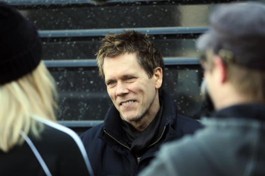 Actor Kevin Bacon talks with friends before going on stage to play in his band, the Bacon Brothers Band, during the Pet Parade in St. Louis on February 3, 2013. UPI/Bill Greenblatt