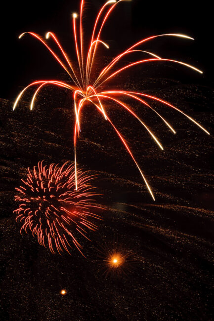 Make sure to control shutter speed when photographing fireworks and vary the shutter speed between 1 to 30 seconds to get different displays of fireworks action.