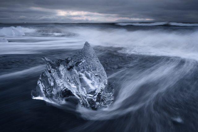 Landscape photo of an iceberg at Jokulsarlon beach in Iceland, taken at an aperture of f/16.