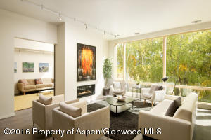 Floor to ceiling windows, wood floors and contemporary styling create a winning combination.